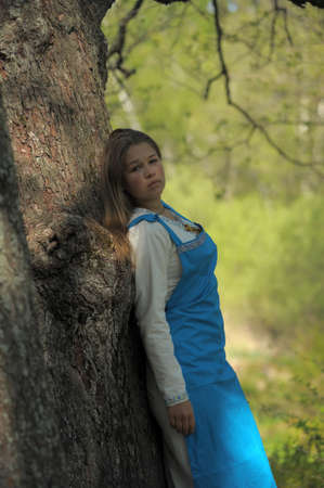 young beautiful girl with blue sundress photo