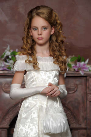 Girl in a smart white dress photo