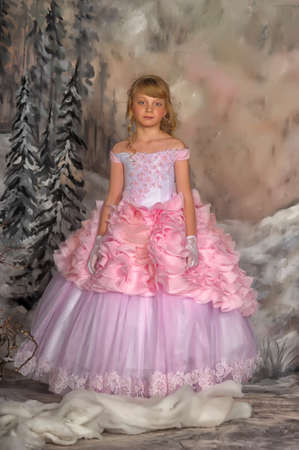 Cute girl in a pink princess dress on winter in studio  photo