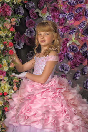 Portrait of little girl in pink dress with flowers  photo