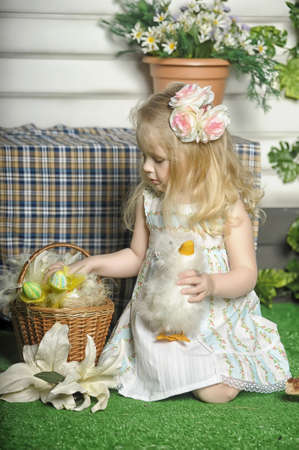 Little girl with basket of easter decoration  photo