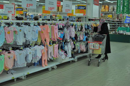 forsale: Shelves with baby clothes in large supermarket