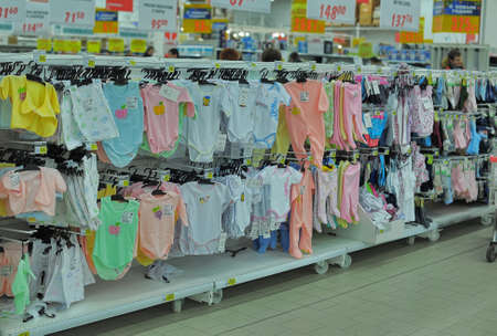 Shelves with baby clothes in large supermarket