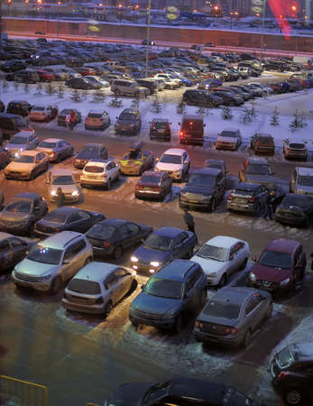 Parking in front of a shopping center in winter, St  Petersburg, Russia