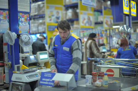 This picture shows a supermarket entrance and cashier desk in Petersburg, Russia