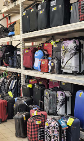 lie forward: Rack with suitcases in supermarket  Editorial