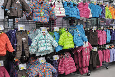 Winter jackets and accessories on stands