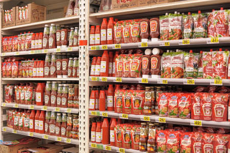 Ketchup and tomato paste on supermarket shelves