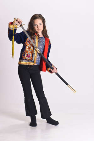 young girl in a Mexican vest, sword in hand photo