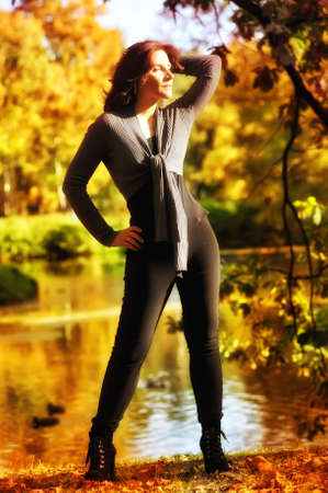 Beautiful girl in gray in the autumn park. photo