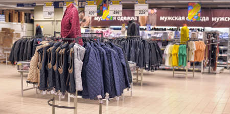 spencer: Mens clothing on hangers in shop