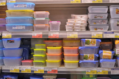 tupperware: Empty plastic containers on the supermarket shelf  Editorial