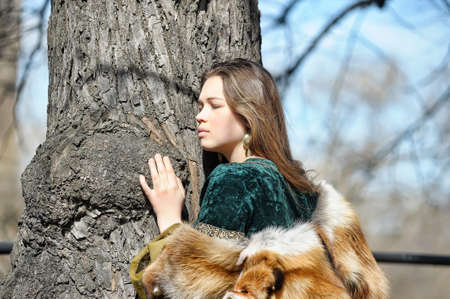 Young woman in medieval dress and fox fur  photo