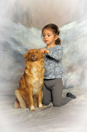 Little girl and her friend the dog  photo