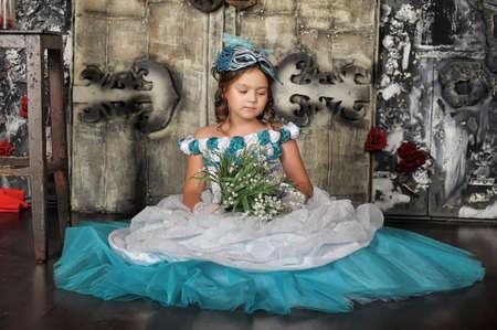 Vintage portrait of girl in blue dress. photo