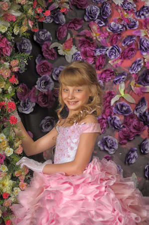 Young beautiful blonde princess in a pink dress. photo