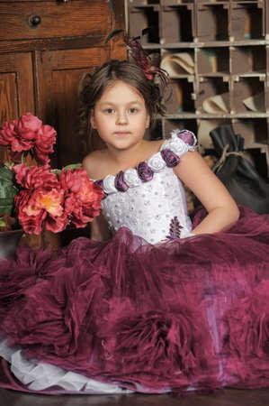 Girl in a purple dress photo
