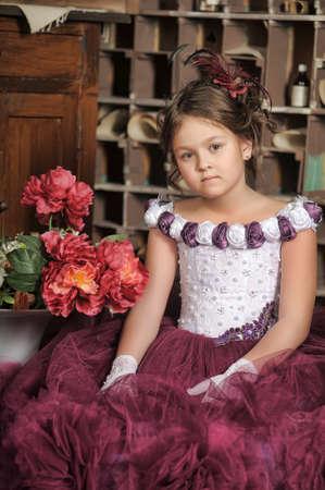 little girl in a purple dress photo