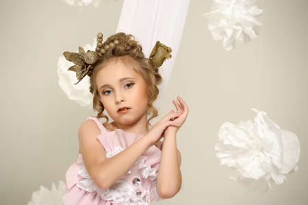 Young magic fairy with gold flowers Stock Photo - 27579922