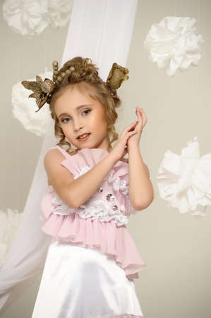 Young magic fairy with gold flowers Stock Photo - 27579923