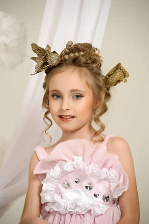 Young magic fairy with gold flowers Stock Photo - 27579925