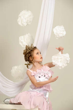 Young magic fairy with gold flowers Stock Photo - 27579926