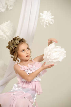 Young magic fairy with gold flowers  Stock Photo - 27579927