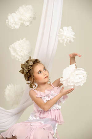 Young magic fairy with gold flowers  Stock Photo - 27579929