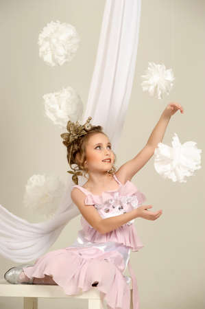 Young magic fairy with gold flowers Stock Photo - 27579930