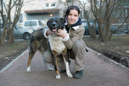 young woman with a dog taken from shelter photo