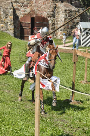 sword act: Knight on horse tournament Editorial