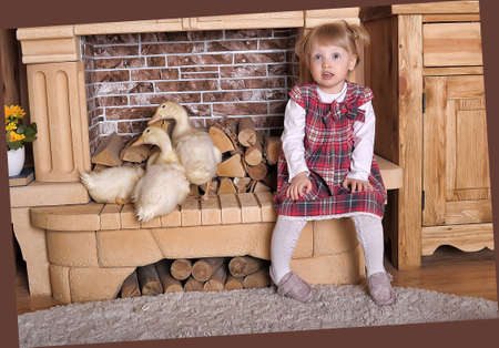 Little girl with baby gosling  photo