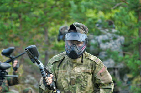 Paintball players with guns