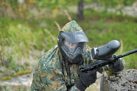 shooters: Paintball players in camouflage Editorial