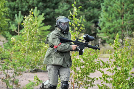 shooters: Paintball players with guns