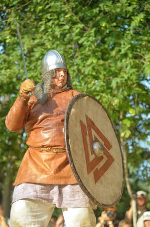 Viking leather shirt with sword, helmet and shield