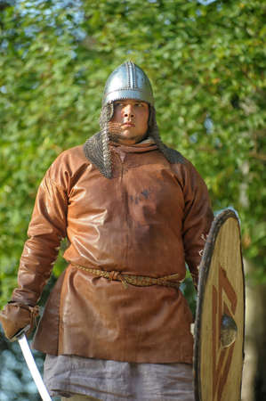 hauberk: Viking leather shirt with sword, helmet and shield
