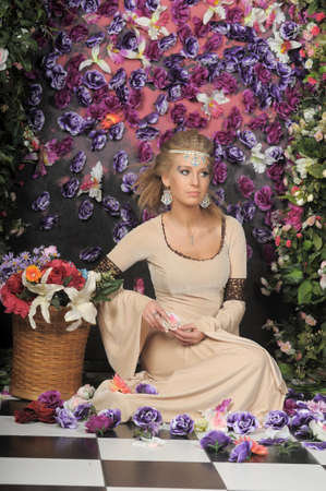 beautiful girl in medieval dress on the fantasy elven flowers  photo