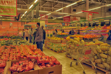 carrefour market: people are buying fruit in a supermarket