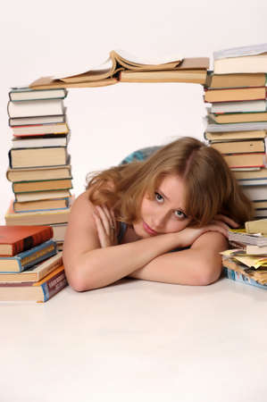 a girl student in the middle of large number of books photo