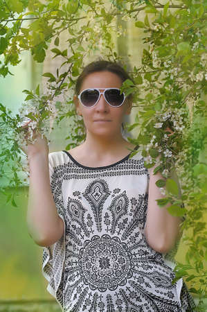 Woman next to a flowering branches photo