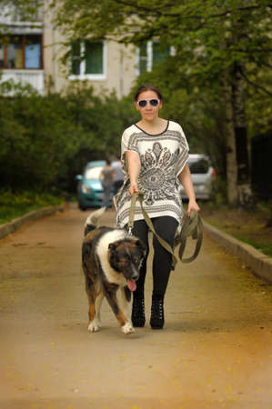 Woman walking with her dog Stock Photo - 28637113