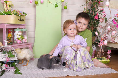 Little children with easter rabbit. photo