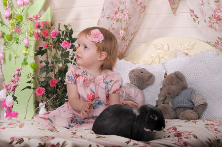 played: Girl with rabbit Stock Photo