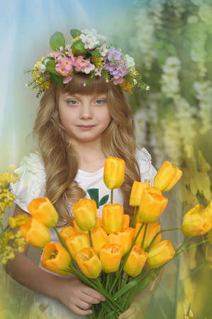 Girl with a bouquet of yellow tulips  photo