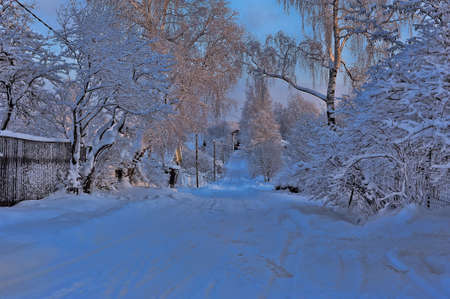 snowy village street, Russia photo