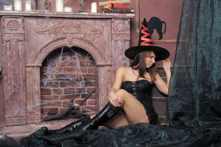 Beautiful girl in a spooky house  photo