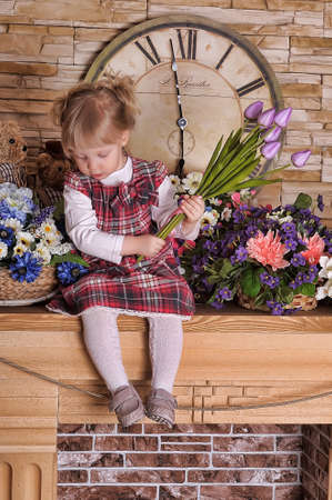 Little girl with a bouquet of tulips in hands photo
