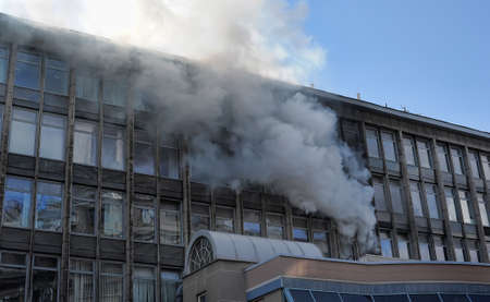 Fire in a highrise building with glass facade  Editorial