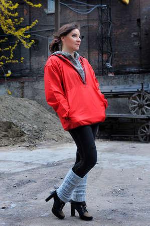 Slim girl in a red windbreaker  Stock Photo - 28775880